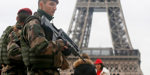 "French soldier patrol near the Eiffel Tower in Paris as part of the highest level of ""Vigipirate"" security"