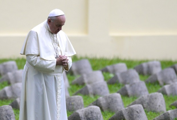 """Pope Francis prays in the military cemetary of the World War I memorial of Redipuglia, near Gorizia, northern Italy, on September 13, 2014. Pope Francis make a penitential pilgrimage to the northeastern Italian war memorial of Redipuglia, where are buried over 100,000 soldiers killed during WWI, to pray for """"the dead of all wars"""" to mark the anniversary of the outbreak of World War I.  AFP PHOTO / OLIVIER MORIN        (Photo credit should read OLIVIER MORIN/AFP/Getty Images)"""