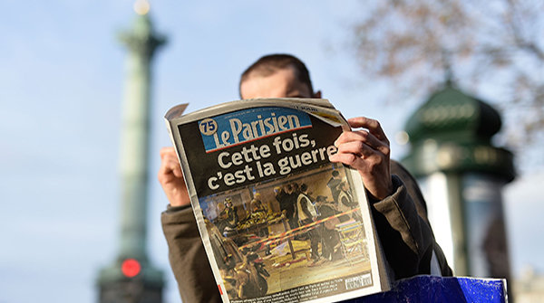 PARIS, FRANCE - NOVEMBER 14:  A man reads a French newspaper after a terrorist attack on November 14, 2015 in Paris, France. At least 120 people have been killed and over 200 injured, 80 of which seriously, following a series of terrorist attacks in the French capital. (Photo by Pascal Le Segretain/Getty Images)